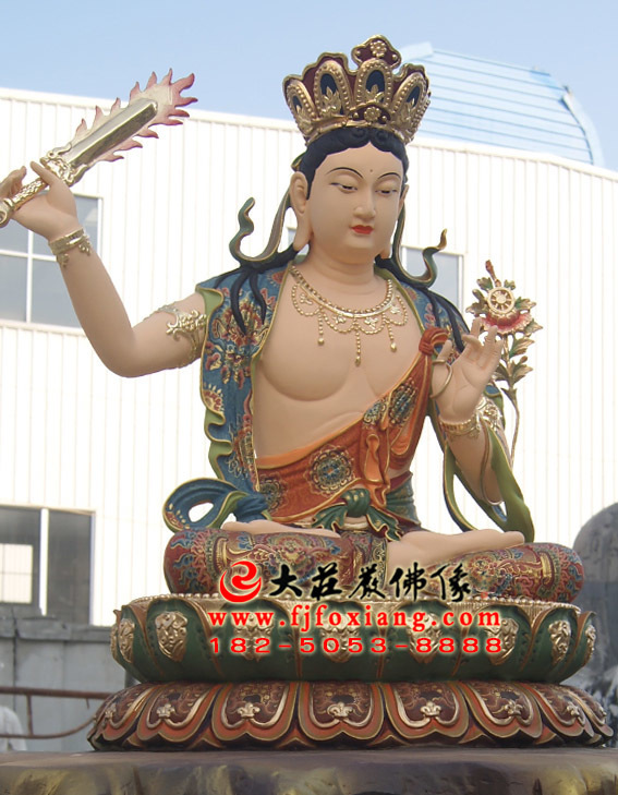 文殊菩萨手持金刚宝剑坐莲彩绘塑像