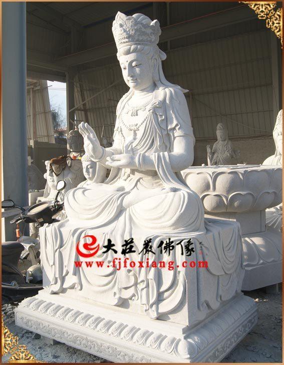 弥勒佛侧面石雕像