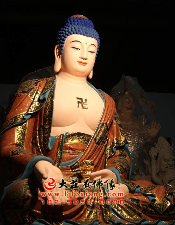 西方三圣之阿弥陀佛彩绘塑像侧面照