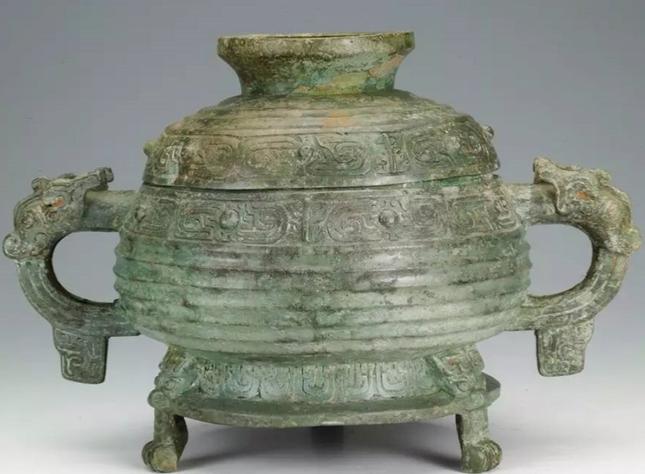 安阳商都殷墟遗址最早出土的青铜器记载与考古